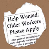 An image of an advert torn from a newspaper asking for older workers to apply