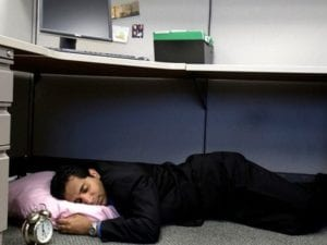 Picture of a man snoozing at work